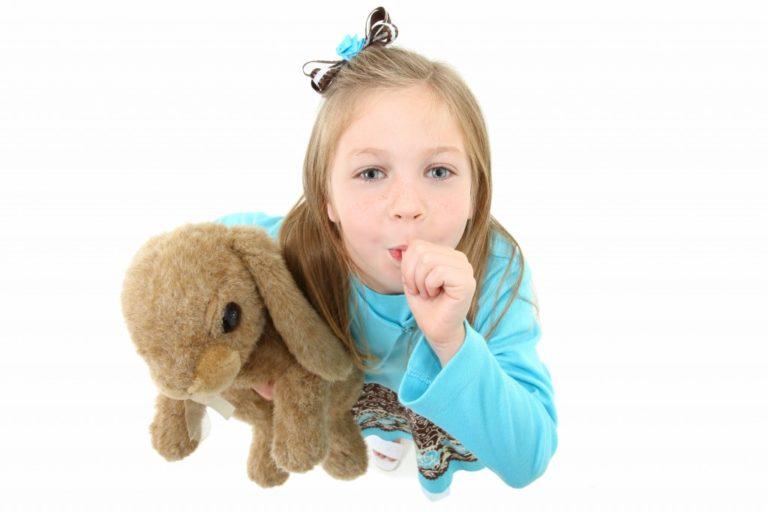 child sucking her thumb