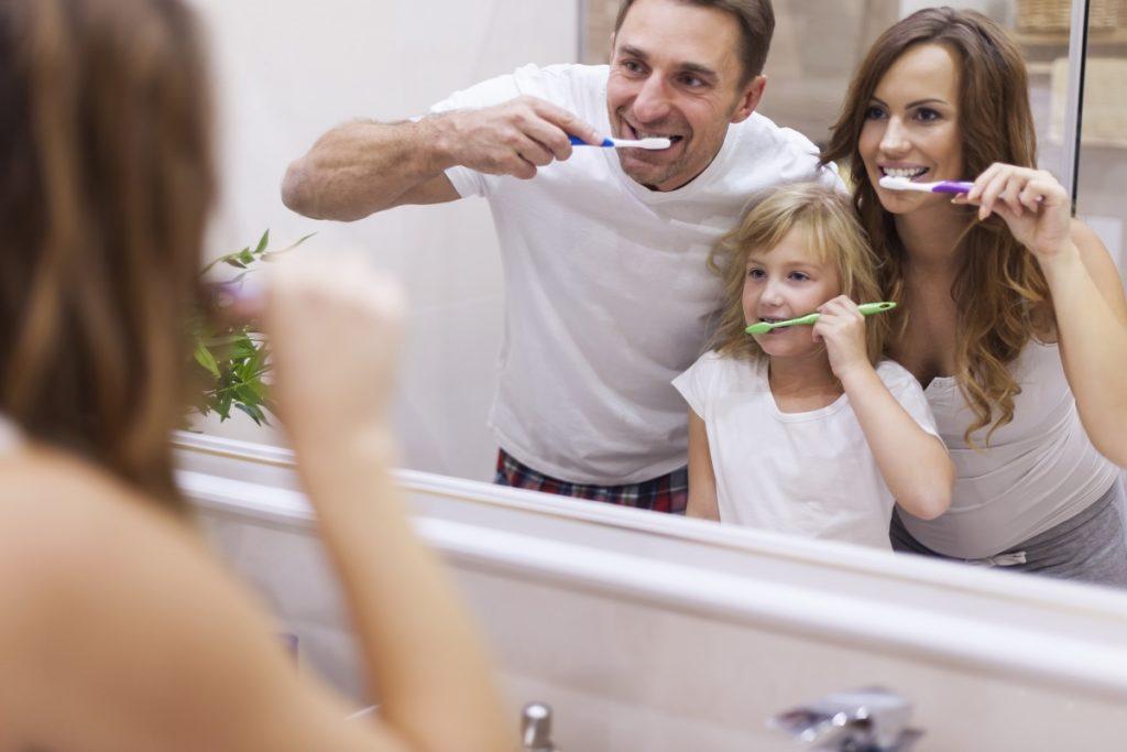 family brushing together