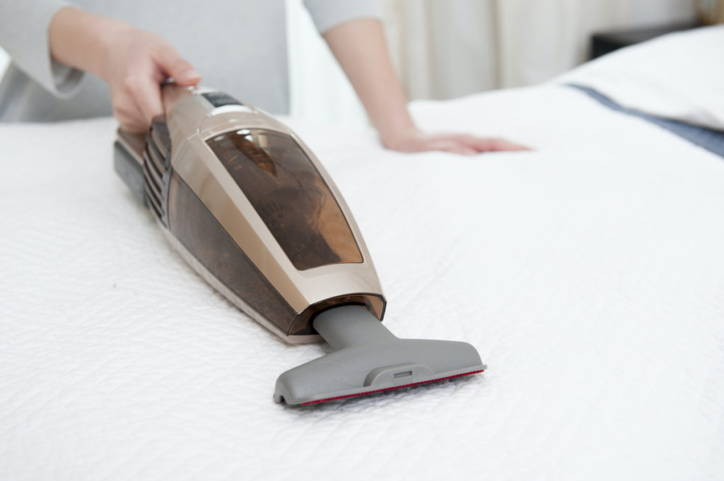 woman using a hand vacuum