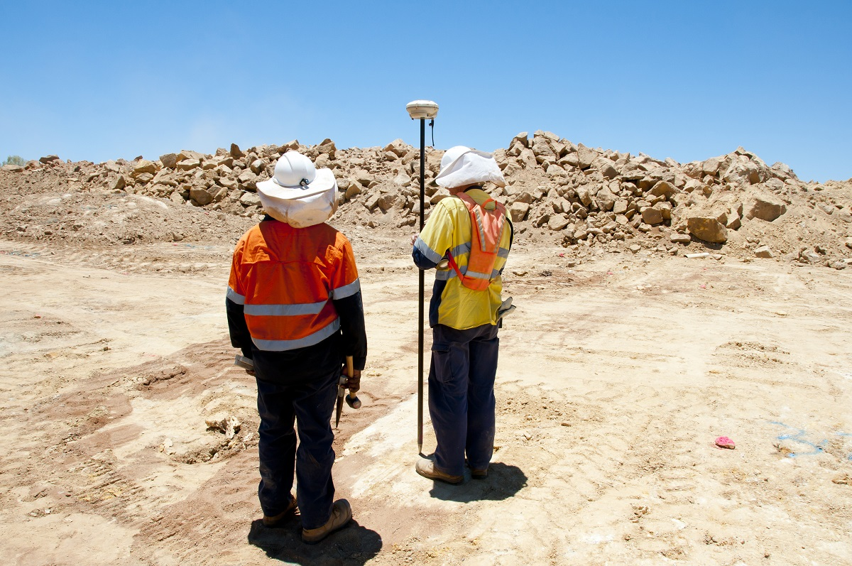 men doing land survey