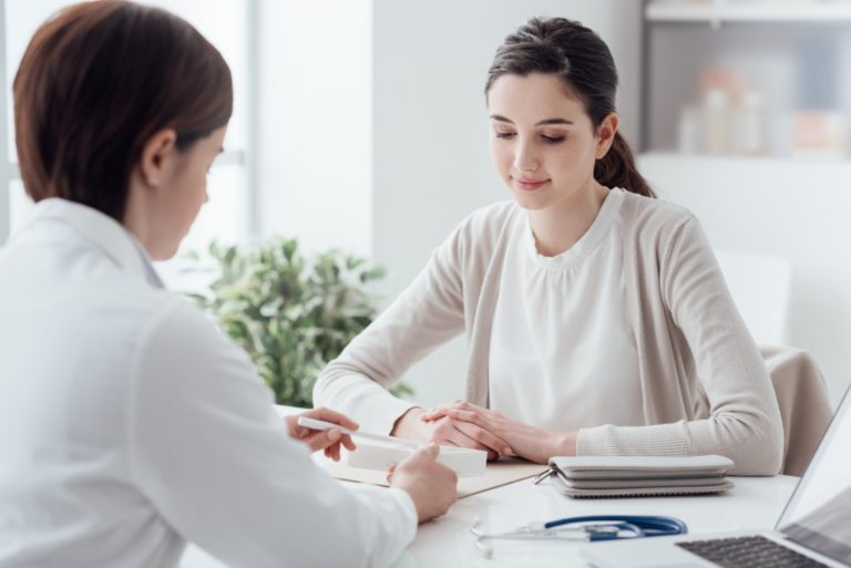 woman consulting a doctor