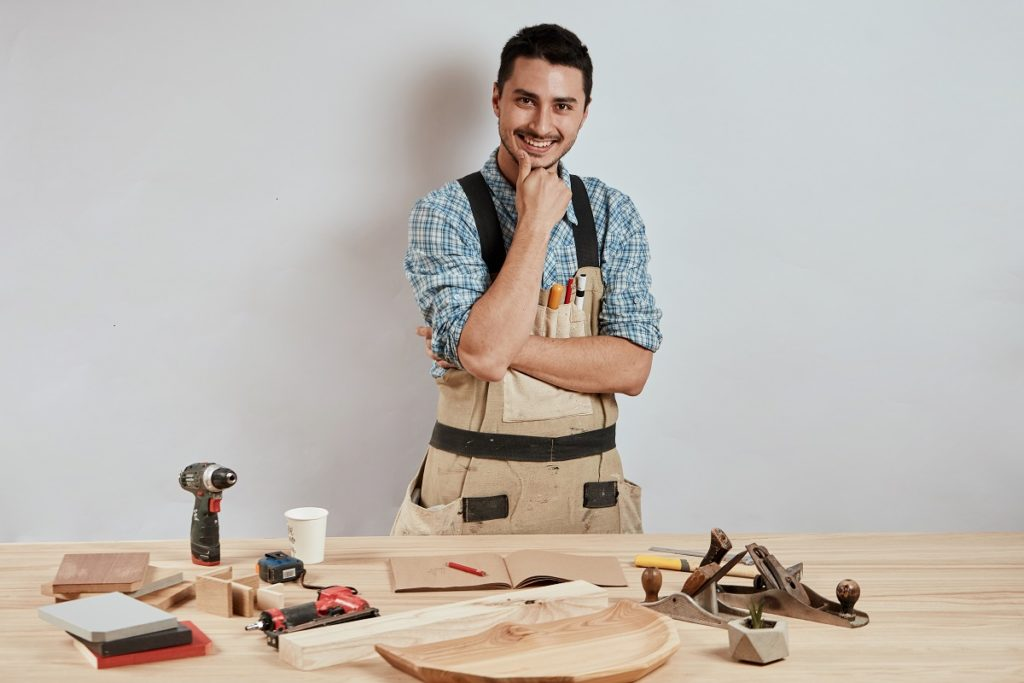 man doing woodwork
