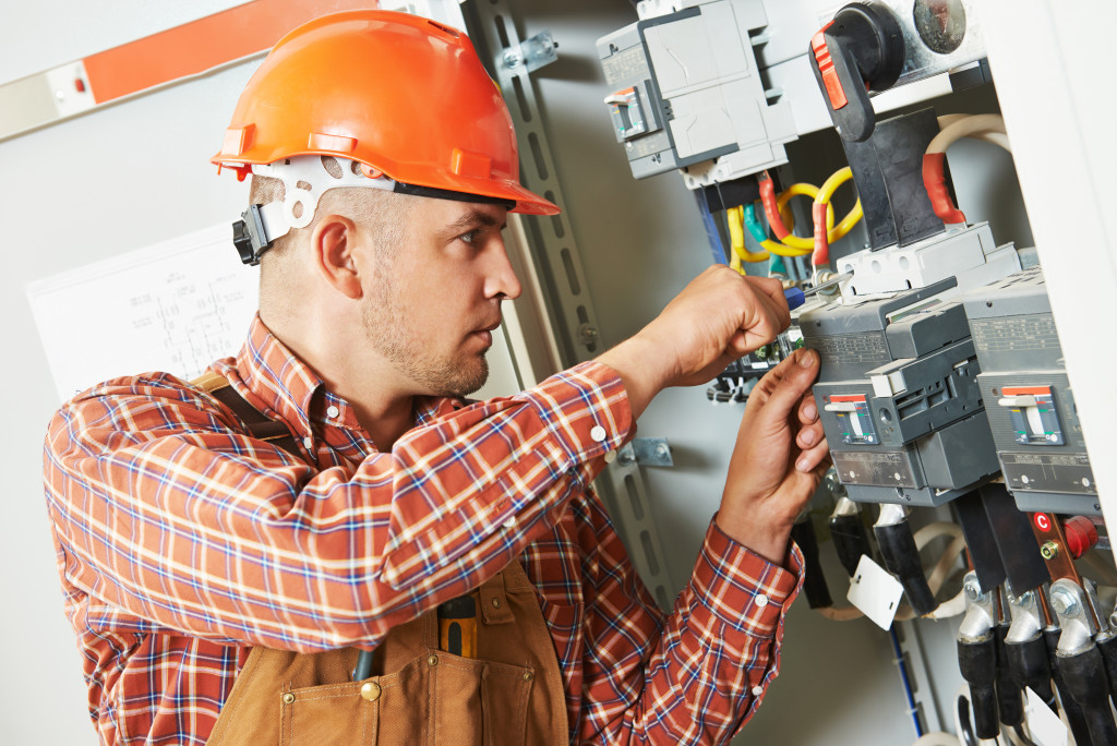 electrician fixing a fuse box