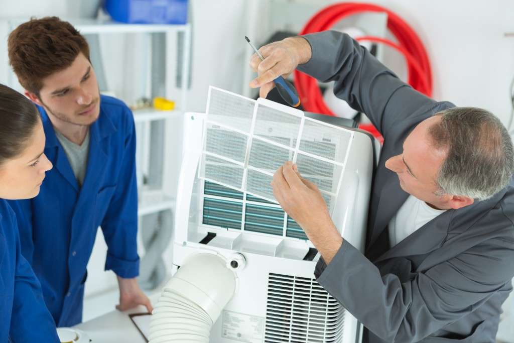 Professionals cleaning the aircon