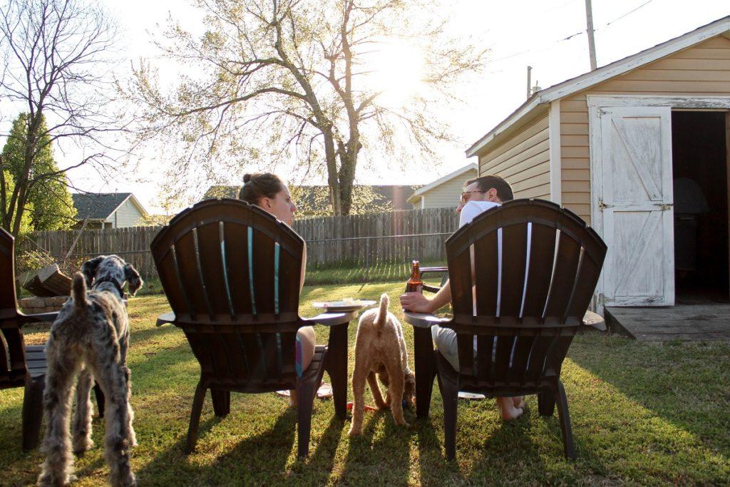 Couple sitting on a backyard