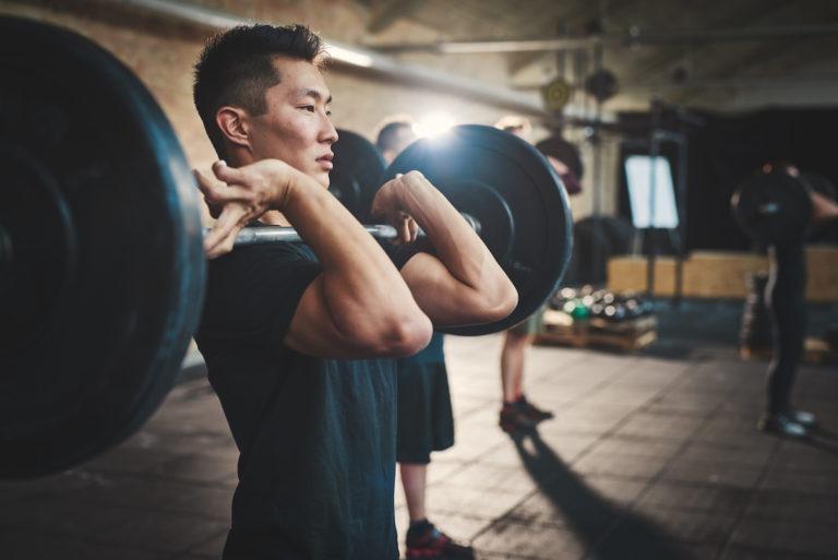 man lifting weights at the gym