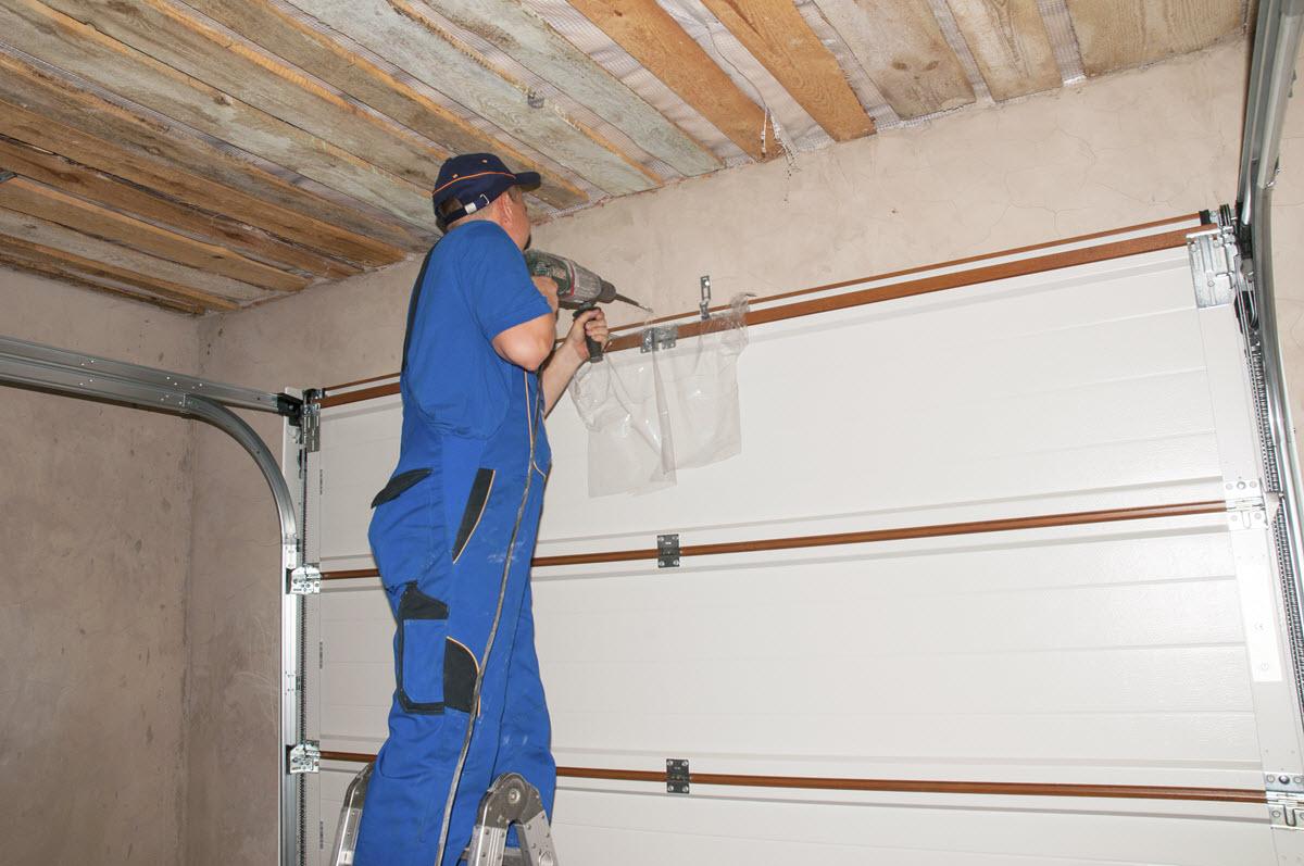 man fixing garage