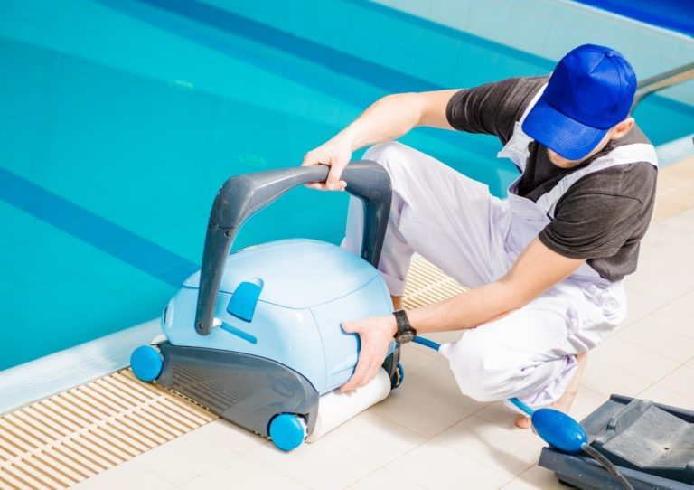 man setting up a pool cleaner