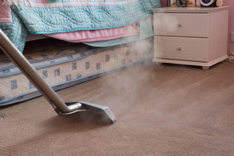 vacuum cleaning the room