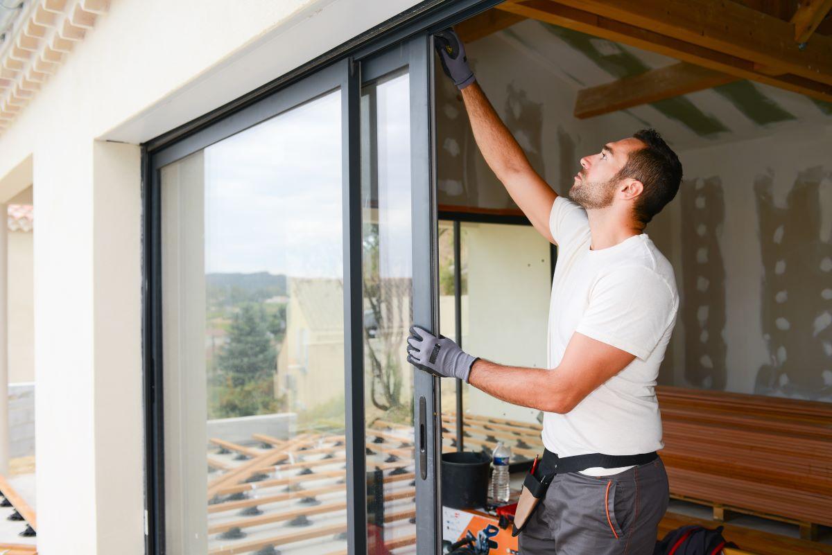 man installing sliding glass door