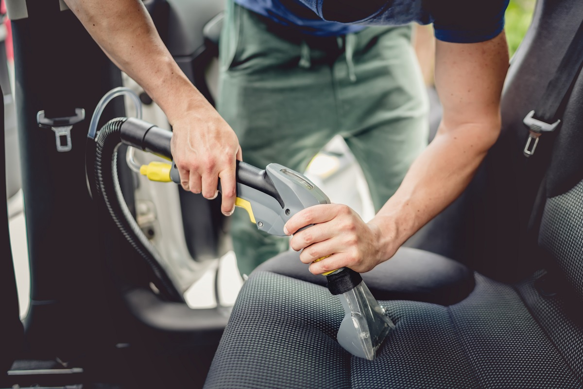 cleaning car with vacuum