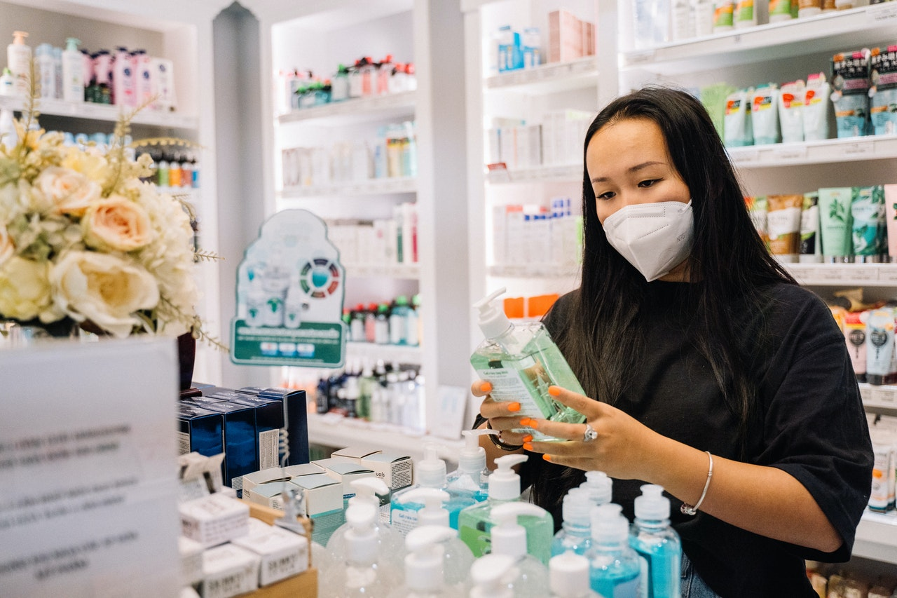 woman buying hand soap