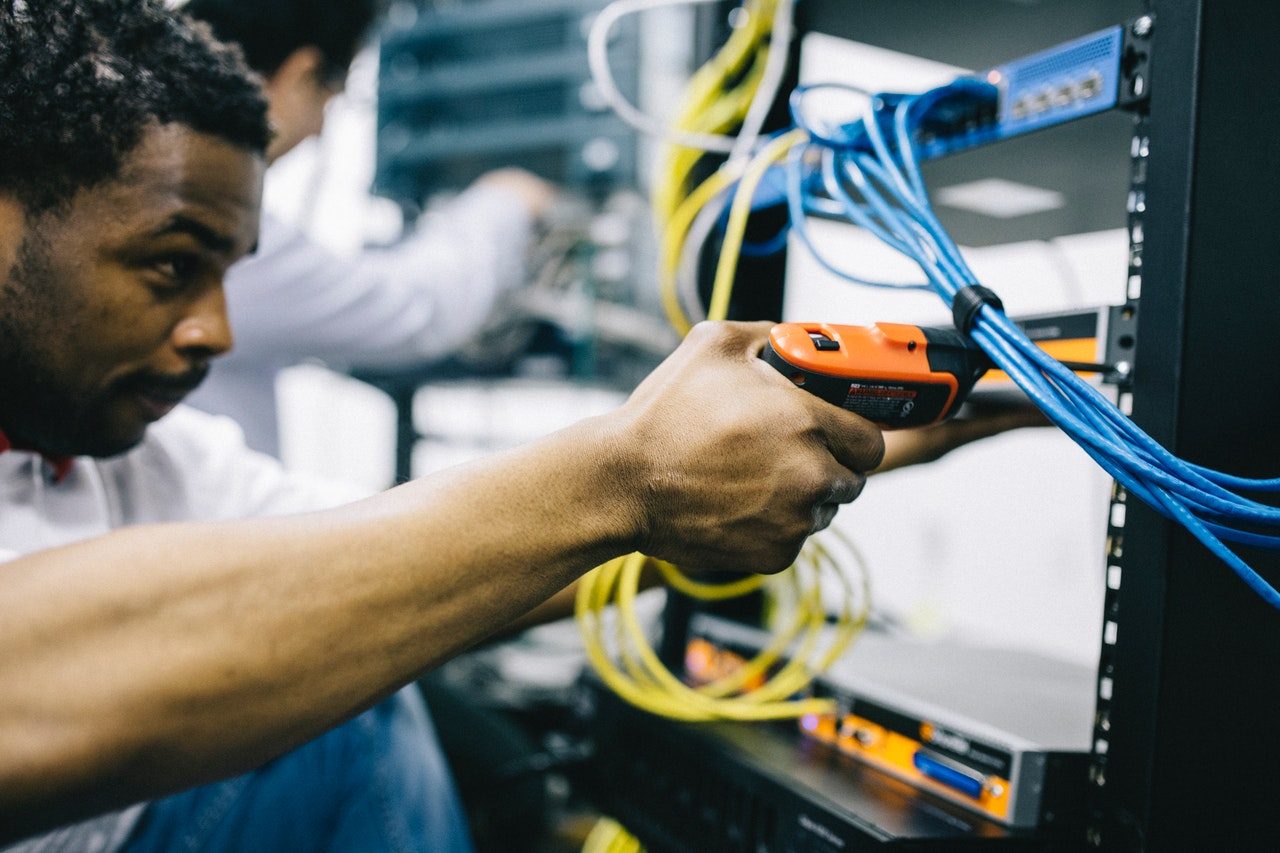 person inspecting wires