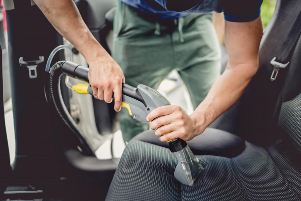 vacuuming car