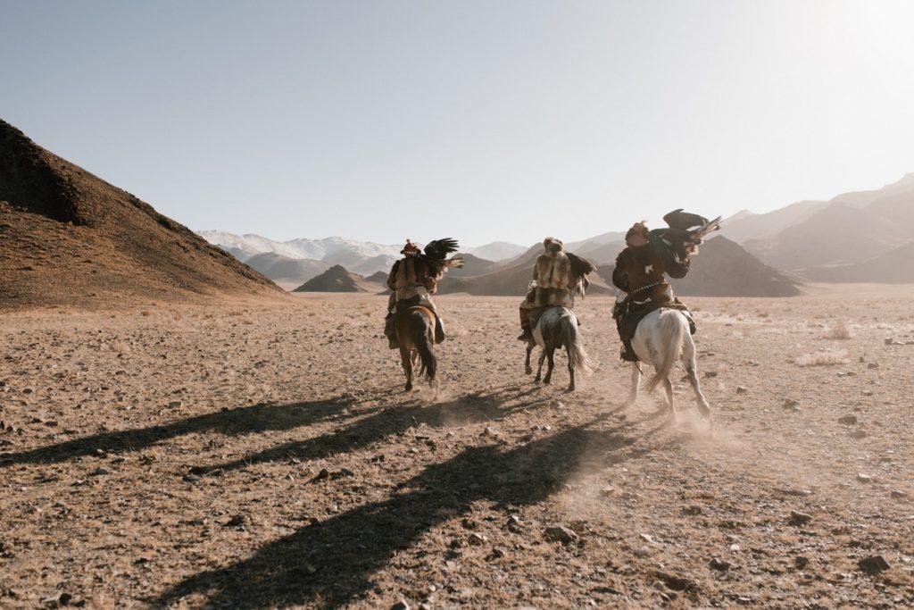 horse riding in the desert