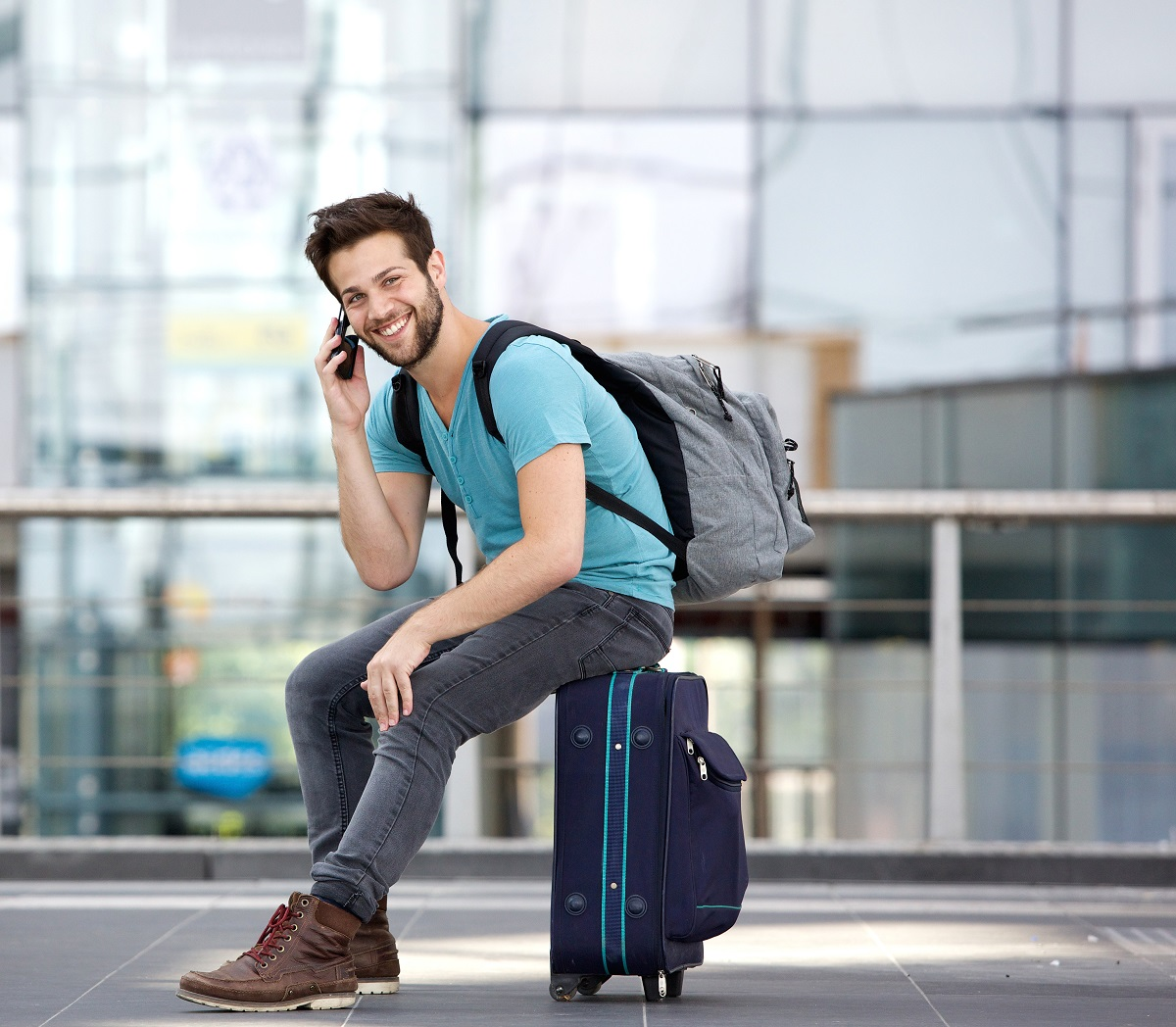 man taking a call on the airport