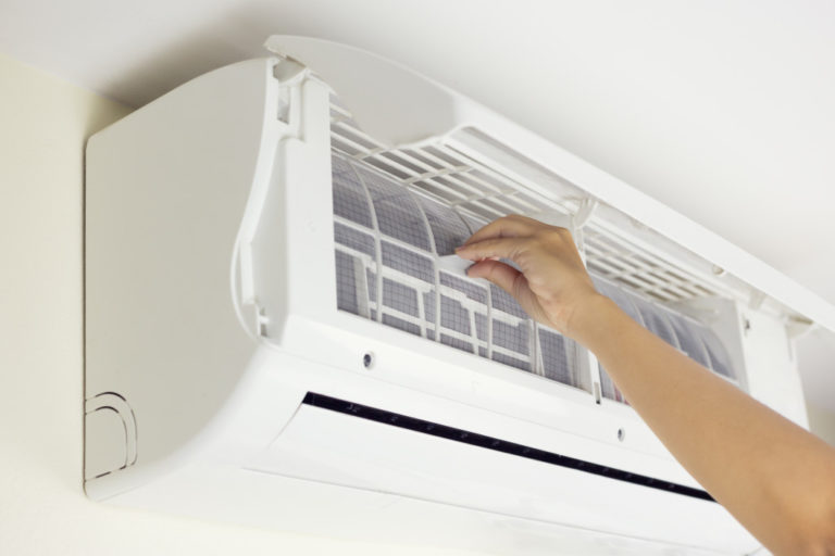 cleaning the AC unit