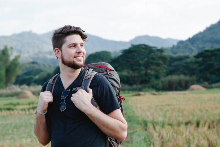 man solo travelling backpacking
