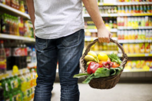 man buying vegetables and fruits