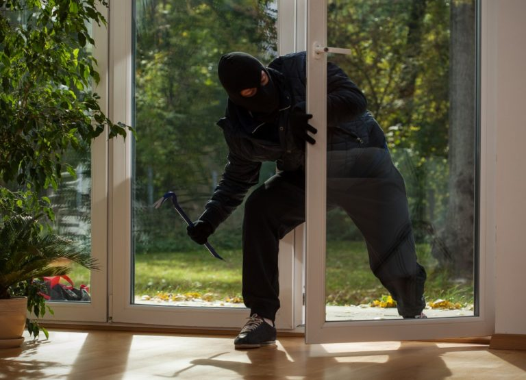 man breaking into a house