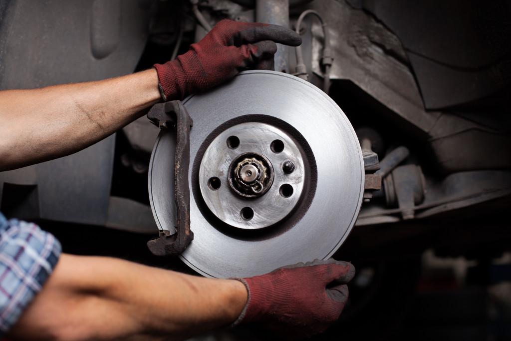 mechanic replacing brakes